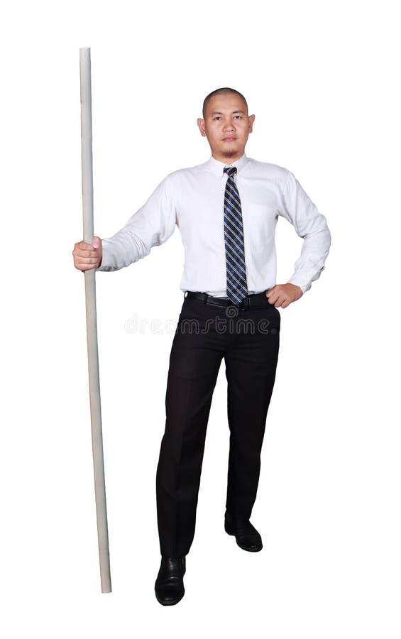 Jonge Aziatische Zakenman Standing Holding een Stok, Vertrouwensgebaar royalty-vrije stock afbeelding