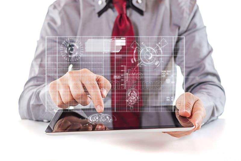 Jonge bedrijfsmens die een digitale PC-tablet gebruiken royalty-vrije stock foto's