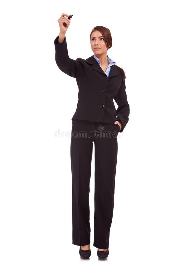 Jonge bedrijfsvrouw die met teller schrijft stock afbeeldingen