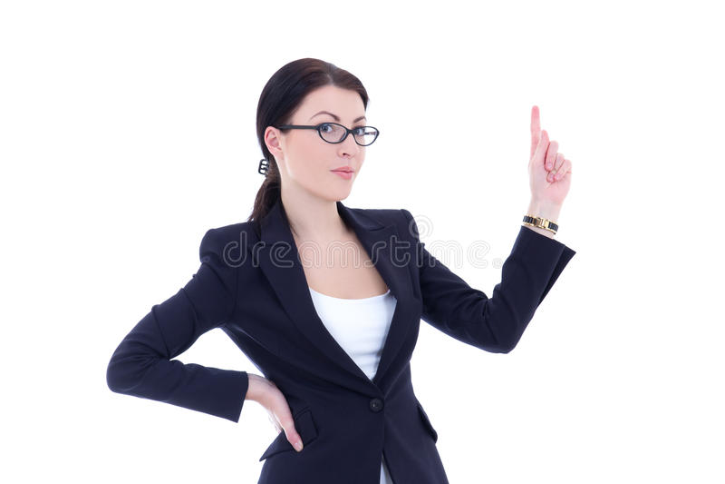Jonge bedrijfsvrouw die op iets richten die tegen w interesseren royalty-vrije stock foto's