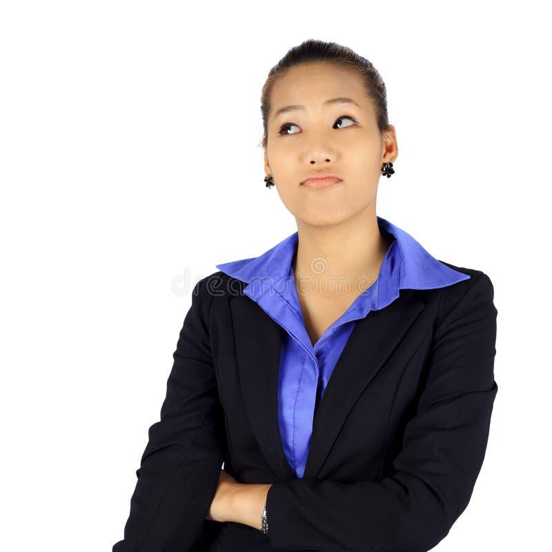 Jonge bedrijfsvrouw met een blik van aarzeling op wit royalty-vrije stock foto