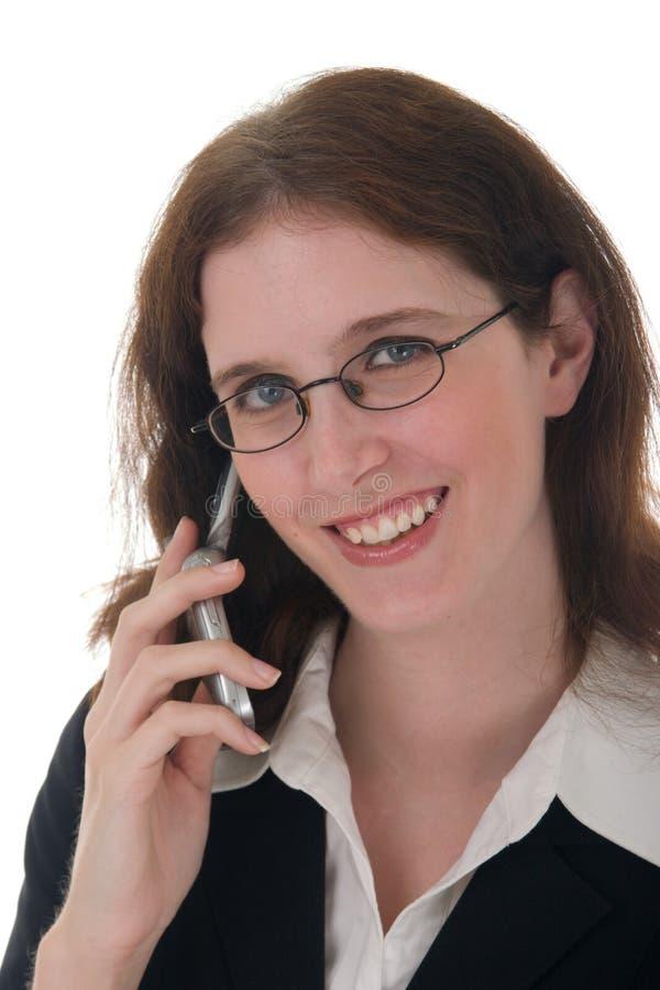 Jonge BedrijfsVrouw met Telefoon 1 van de Cel stock afbeelding
