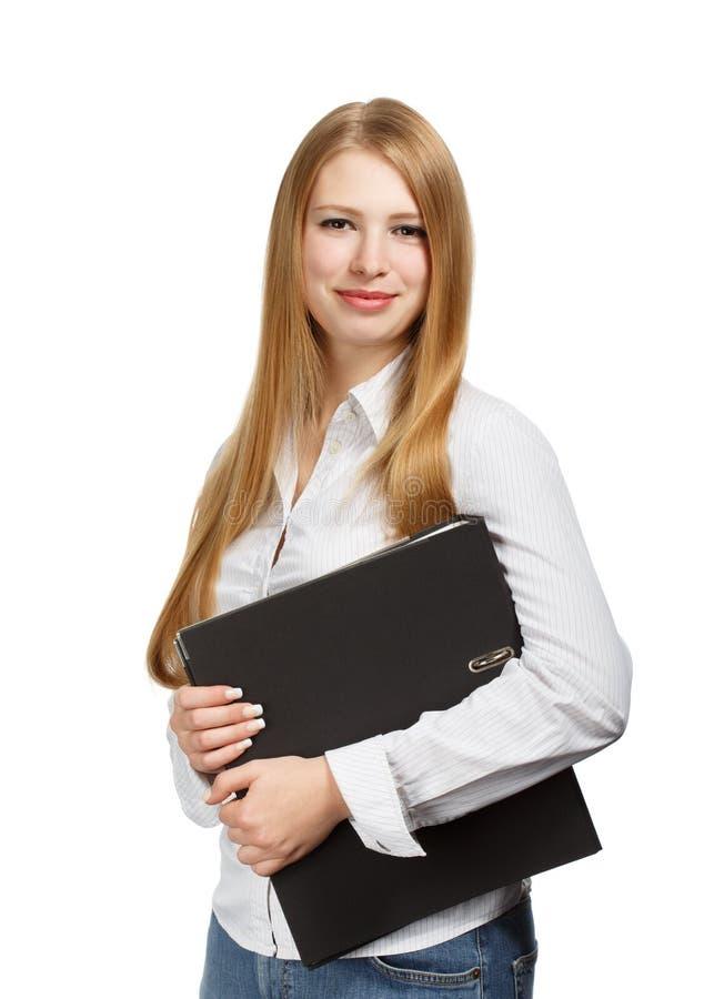 Jonge bedrijfsvrouw met zwarte omslag op witte achtergrond royalty-vrije stock fotografie