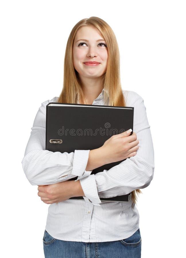 Jonge bedrijfsvrouw met zwarte omslag op witte achtergrond royalty-vrije stock foto's