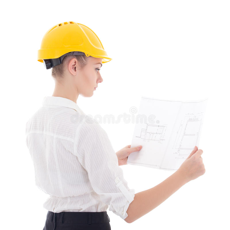 Jonge bedrijfsvrouwenarchitect in gele bouwershelm met bui stock foto's