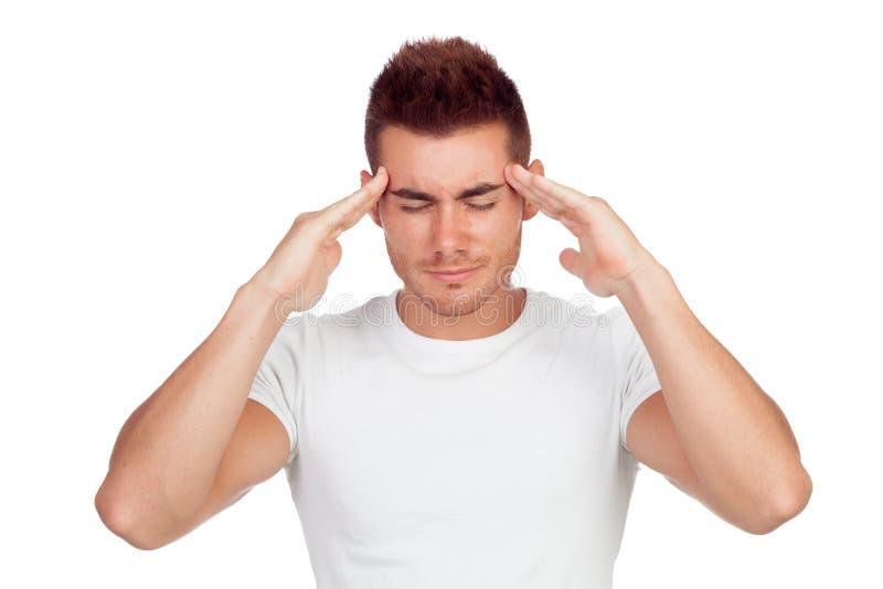 Jonge blonde mens met hoofdpijn stock afbeelding