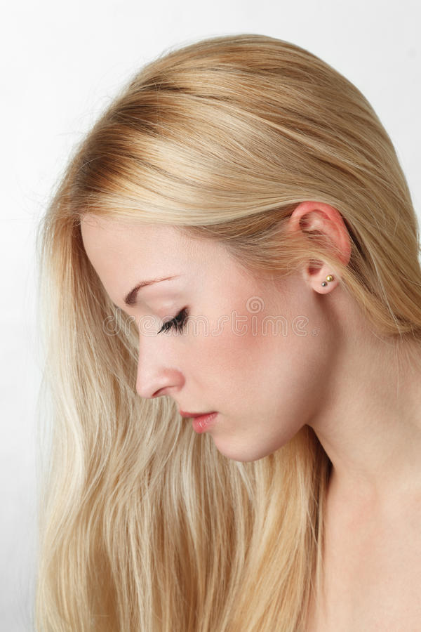 Jonge blonde vrouw royalty-vrije stock foto