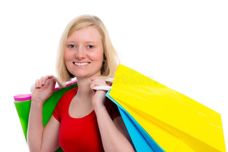 Jonge blonde vrouw met het winkelen zakken stock afbeelding