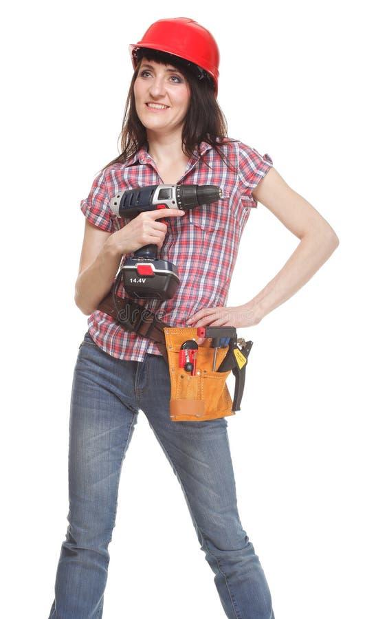 Jonge bouwersvrouw met een boor stock foto
