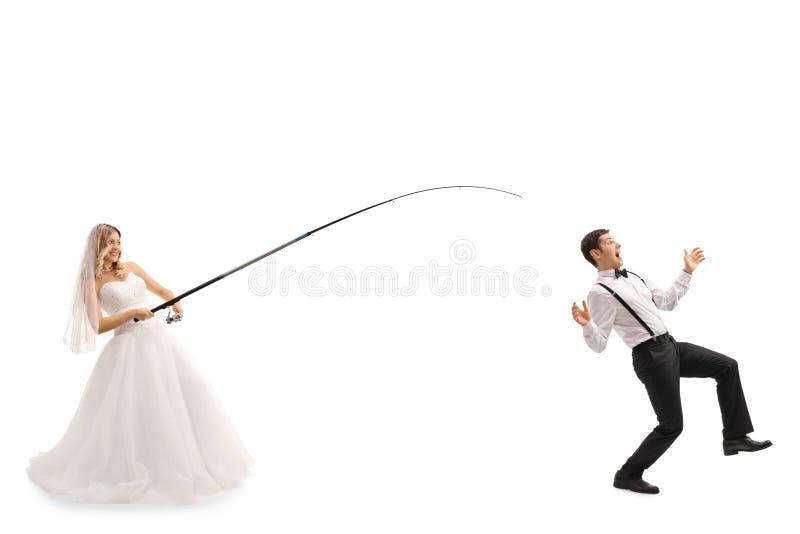 Jonge bruid die voor een bruidegom vissen royalty-vrije stock afbeeldingen