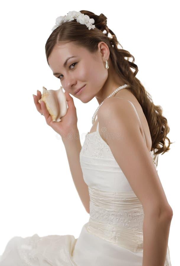 Jonge bruid met overzeese shell royalty-vrije stock afbeelding