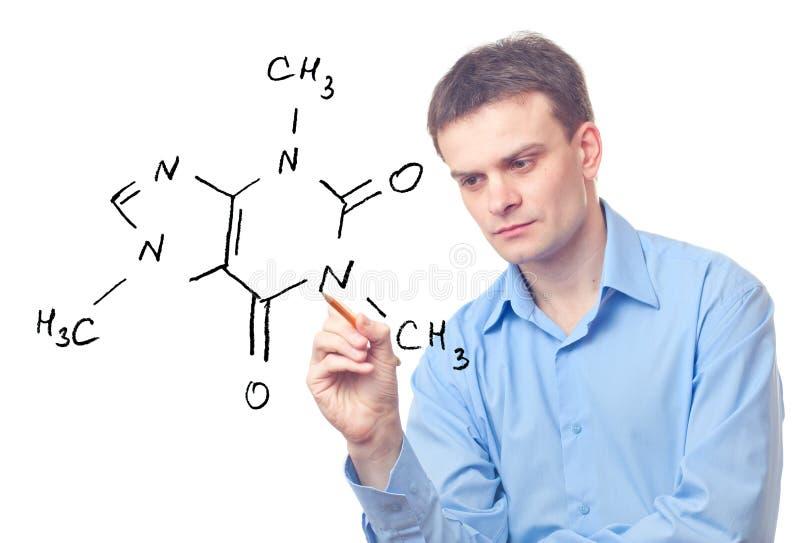 Jonge chemicus en formule van cafeïne stock afbeeldingen
