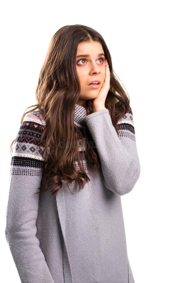 Jonge dame met met afschuw vervuld gezicht stock foto's