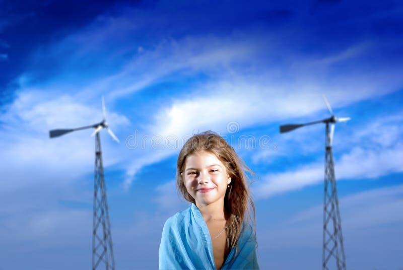 Jonge dame met windgenearators royalty-vrije stock foto's