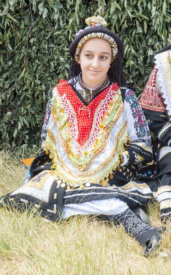 Jonge deelnemer van het Griekse volksensemble bij het festival Rozhen in Bulgarije royalty-vrije stock foto