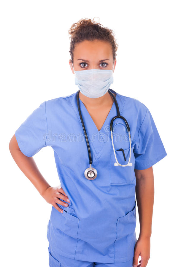 Jonge die arts met masker en stethoscoop op witte backgro wordt geïsoleerd royalty-vrije stock fotografie