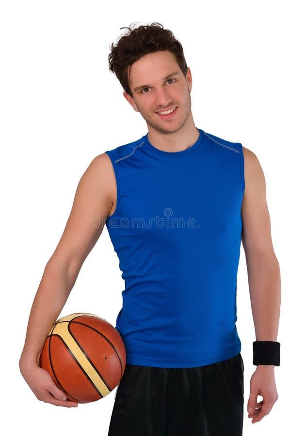 Jonge die basketbalspeler op witte achtergrond wordt geïsoleerd royalty-vrije stock afbeeldingen