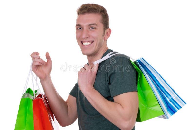 Jonge die mens met het winkelen zakken, op wit wordt geïsoleerd royalty-vrije stock foto's