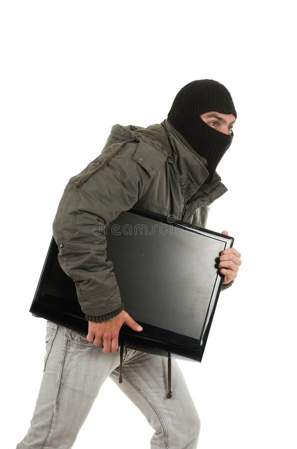 Jonge dief die zwart kap en jasje dragen stock fotografie