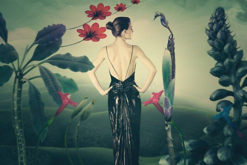 Jonge elegante vrouw in denkbeeldige landschaps samengestelde foto stock afbeeldingen