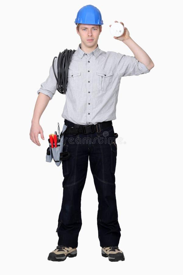 Jonge elektricien stock afbeelding