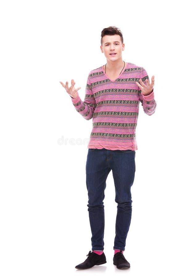Jonge en mens die spreekt verklaart stock foto