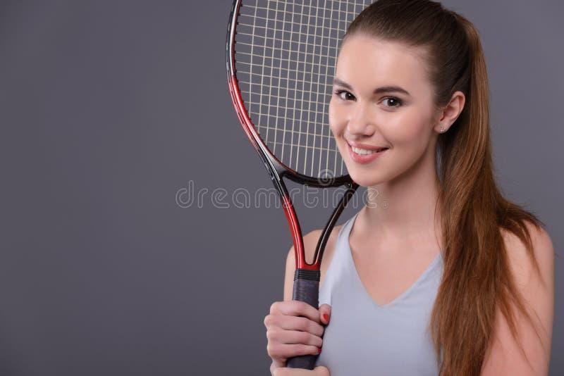 Jonge en sexy tennisspeler stock fotografie
