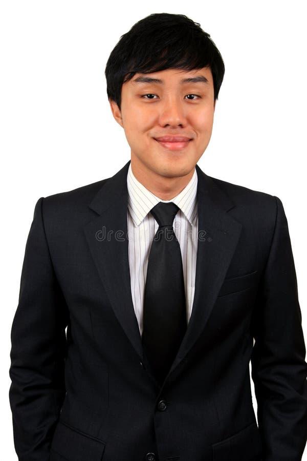 Jonge en zekere Aziatische bedrijfsmens. stock afbeeldingen