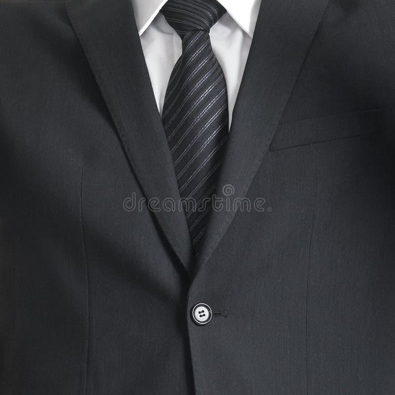 Jonge en zekere bedrijfsmens Zakenman in kostuum op wit wordt geïsoleerd dat royalty-vrije stock foto's