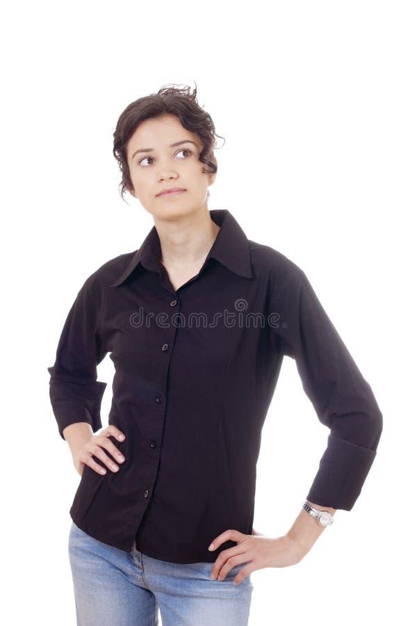 Jonge ernstige vrouw status stock fotografie