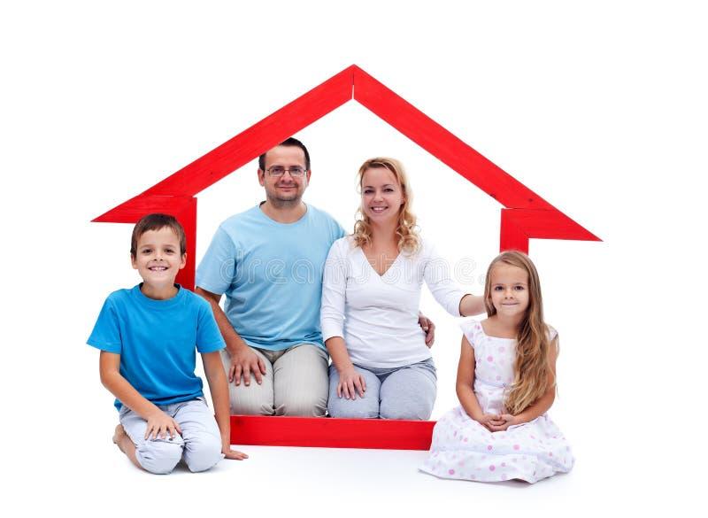 Jonge familie in hun huisconcept stock afbeeldingen