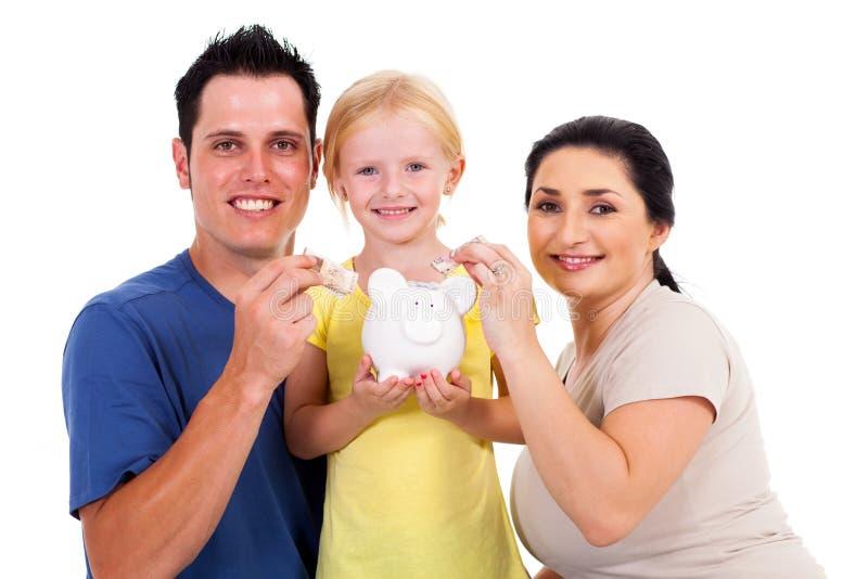 Jonge familiebesparing stock afbeelding