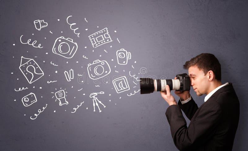 Jonge fotograaf die fotografiepictogrammen schieten stock afbeelding