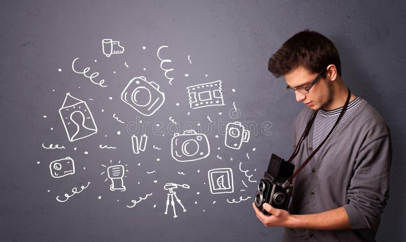 Jonge fotograaf die fotografiepictogrammen schieten royalty-vrije stock foto's