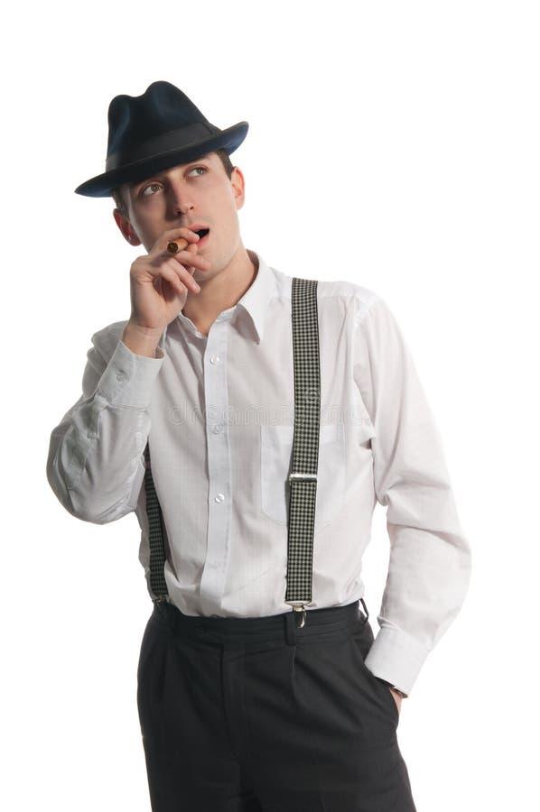 Jonge gangstermens met cigare stock fotografie