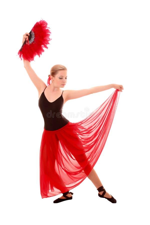 Jonge geïsoleerdet vrouw in rode kleding met ventilator royalty-vrije stock fotografie