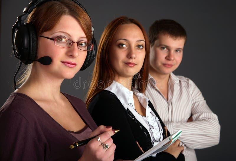Jonge gelukkige en succesvolle businesspeople drie stock afbeeldingen