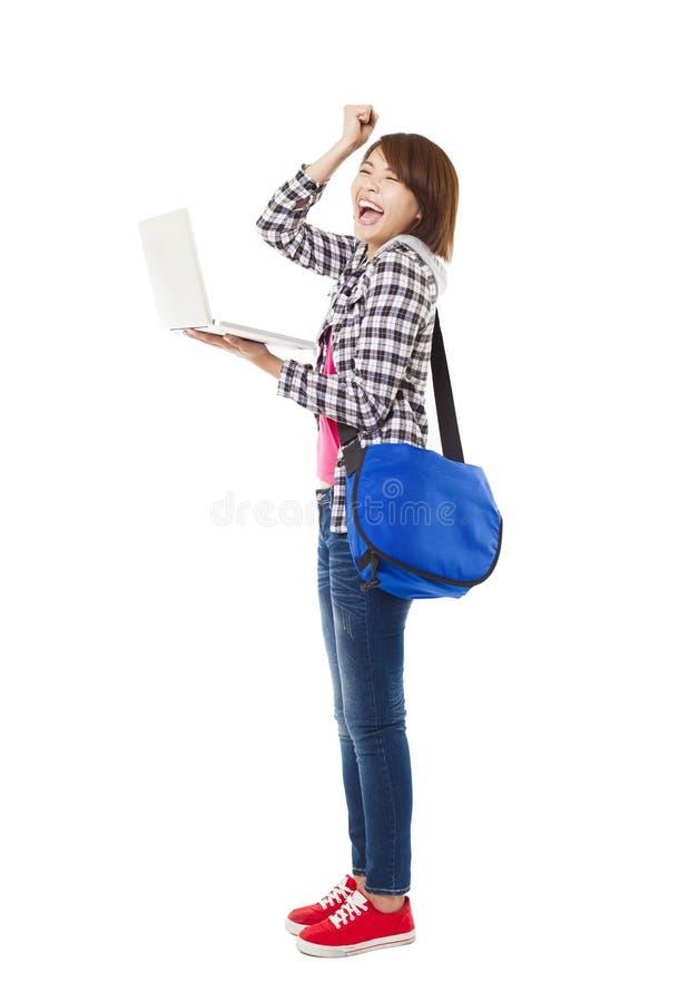 Jonge gelukkige student met laptop royalty-vrije stock foto's