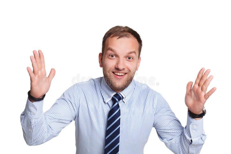 Jonge gelukkige verraste die zakenman op wit wordt geïsoleerd royalty-vrije stock foto