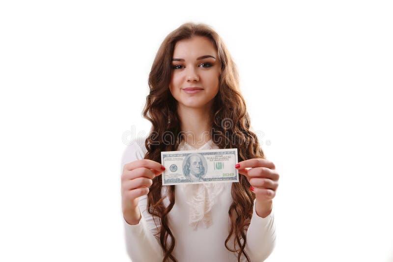 Jonge gelukkige vrouw met in hand dollars boven het beeld - een citaat van de voorzitter John F royalty-vrije stock afbeelding