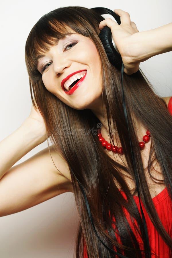 Download Jonge Gelukkige Vrouw Met Hoofdtelefoons Stock Foto - Afbeelding bestaande uit leuk, kijk: 54092808