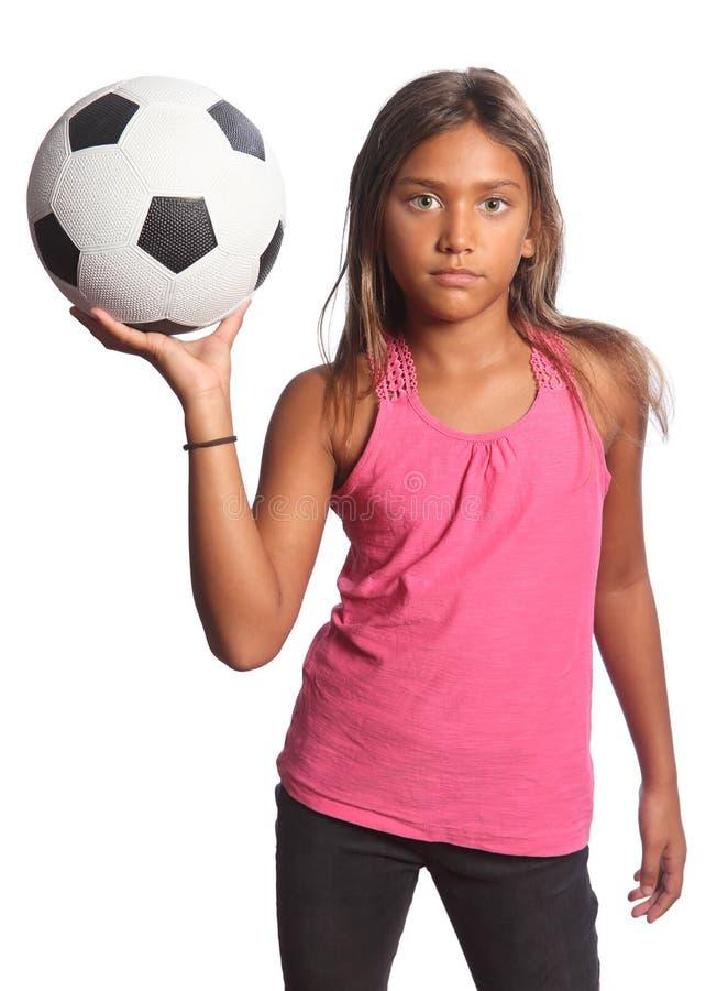 Jonge gemengde van de het meisjesholding van de rasschool het voetbalbal royalty-vrije stock afbeeldingen