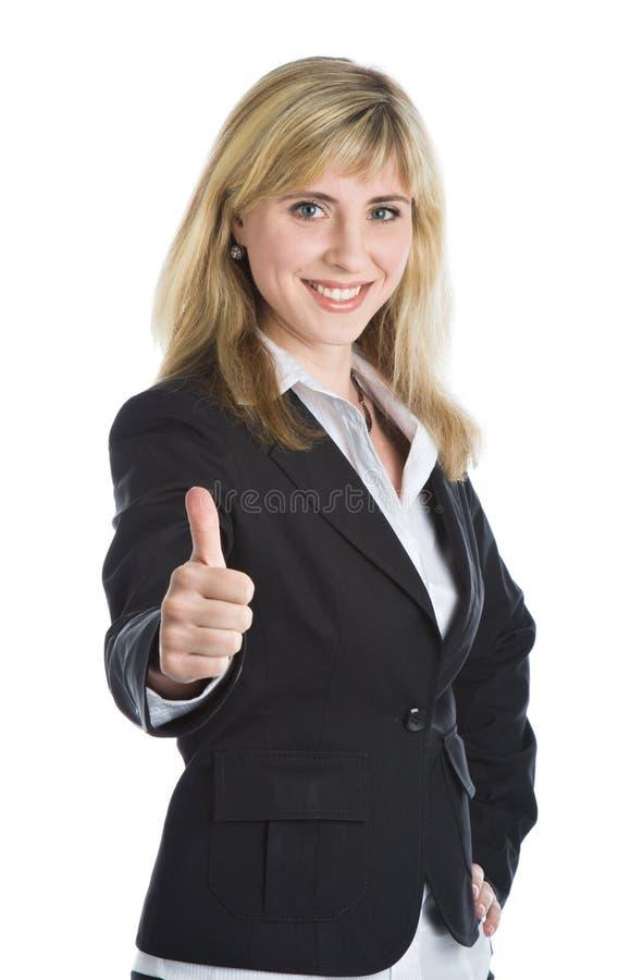 Jonge glimlachende vrouw in een pak stock afbeeldingen