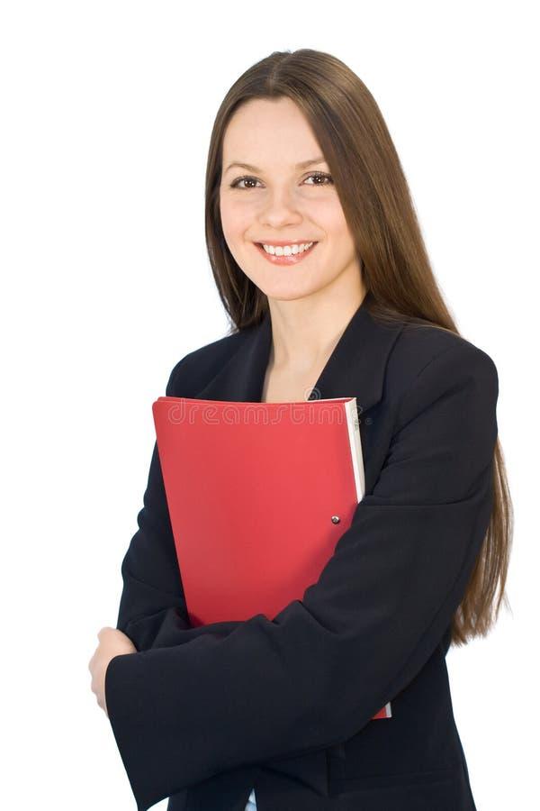Jonge glimlachende vrouw met een omslag in handen stock afbeelding