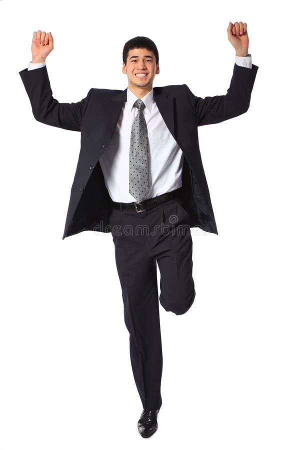 Jonge glimlachende zakenman met opgeheven handen royalty-vrije stock afbeeldingen