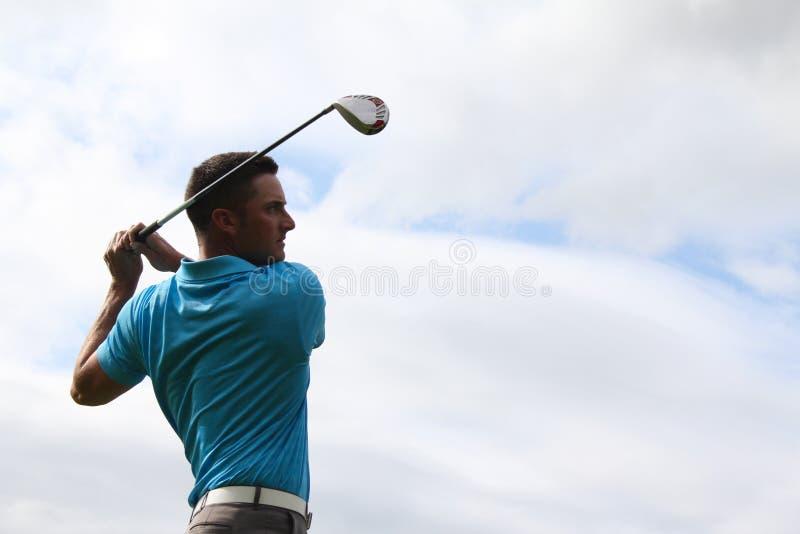 Jonge golfspeler stock afbeelding