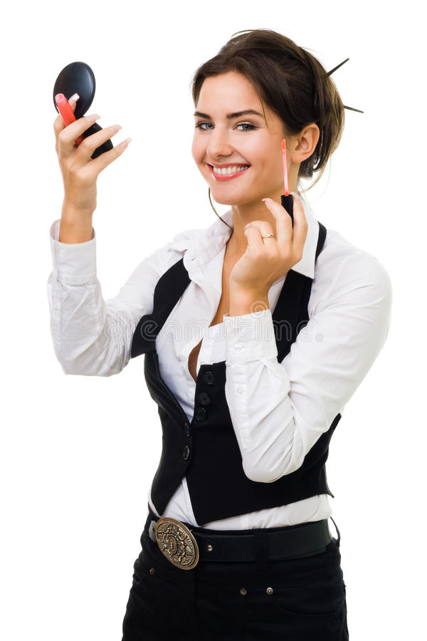 Jonge het glimlachen vrouwenmake-up zelf stock foto