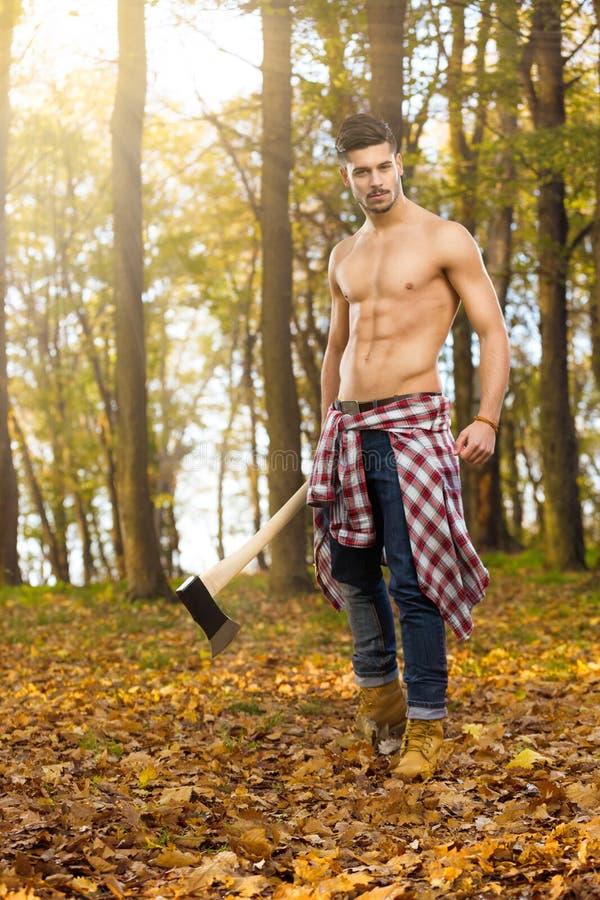 Jonge houthakker stock afbeelding