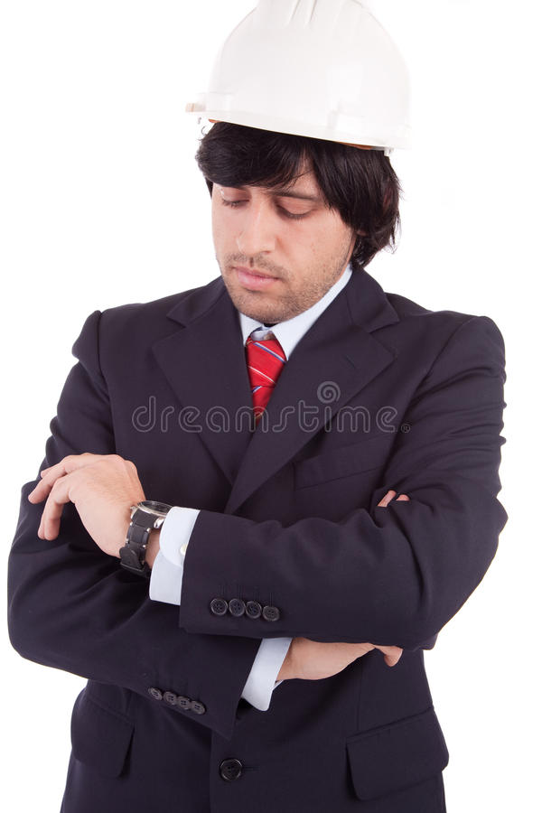 Jonge Ingenieur die zijn horloge raadpleegt stock fotografie