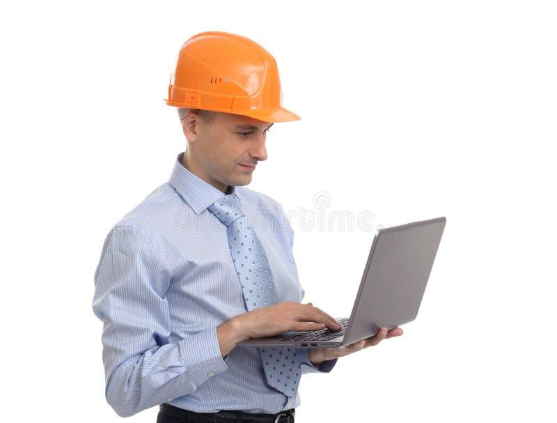 Jonge ingenieur met laptop royalty-vrije stock foto's